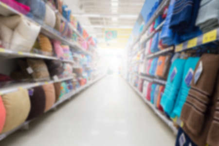 store shelf: abstract blurred shelf of pillow and towel on the department store. Stock Photo