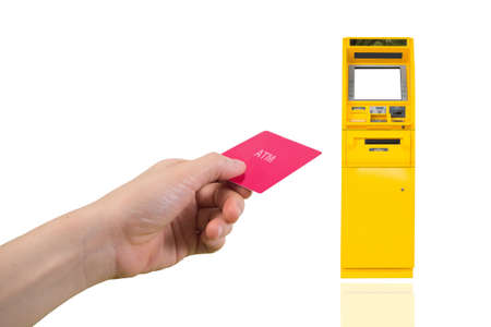 Human hand insert card on Automatic Teller Machine on isolated white background, financial transactions concept.