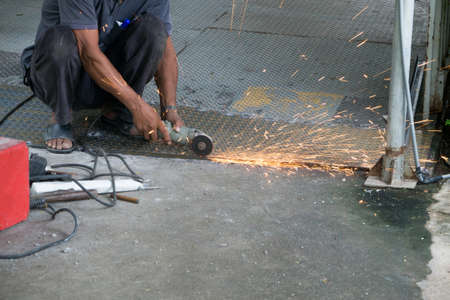 technician was cutting steel, fire sparkle on Operational risk concept.
