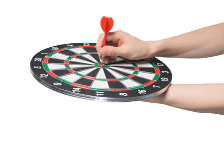 human hand hold black and white target dart board with pointing on top score target on isolated white background, Business successful concept.