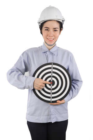 headman: Asian Women wearing a helmet and protective clothing pointed finger on dartboard . Concept of working women in safety target and successful business. young woman holding dartboard.