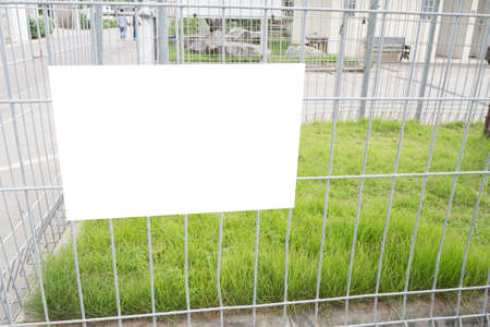 white copy space  label on cage at restricted area, concept of warning sign on private area. Stock Photo