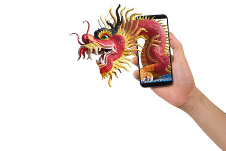 human hand hold smartphone, tablet, cell phone with big dragon statue come out screen. concept of celebrate Chinese New Year background with , concept of the Year of the Dragon.