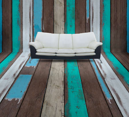 parquet floor layer: modern sofa on wood colorful wood floor. concept of interior house design. Stock Photo