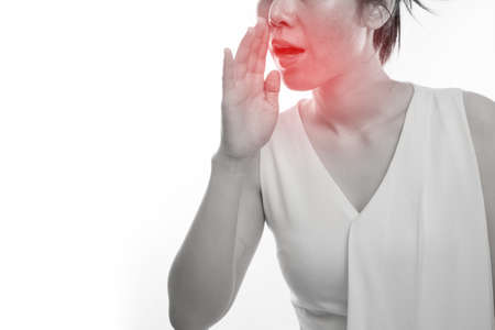 Young asian woman having Bad breath on isolated white background, concept of health care lifestyle. Stock Photo