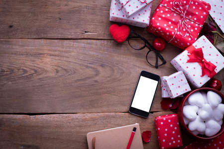 Blank screen smart phone, cell phone, with Valentines day Decoration, Valentines Day celebration background, top view.
