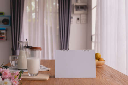 breakfast table with blank screen for text on calendar, copy space. Zdjęcie Seryjne