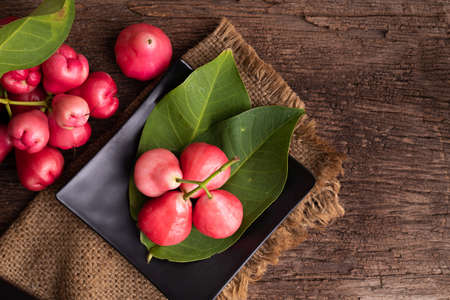 pink rose apple on wood table, asian tropical fruit.