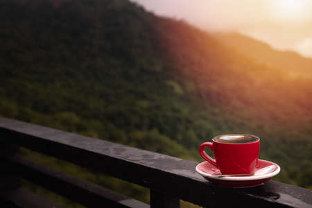 morning latte coffee cup with mountain background, coffee break. 版權商用圖片