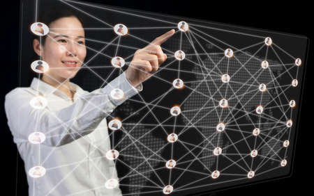 Business development to success and connecting concept, Businesswoman Pointing virtual interface connection people on world map.