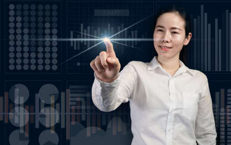 smiling businesswoman touching virtual screen, business startup as concept, trendy girl. 版權商用圖片