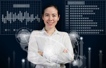 smiling asian trendy girl cross ones arm on virtual business reports and graphs, concept of woman manager.