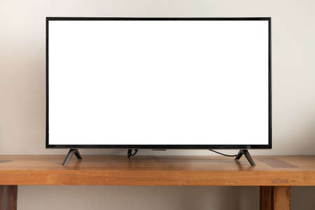 blank screen television on wooden table at living room, copy space for text on TV.