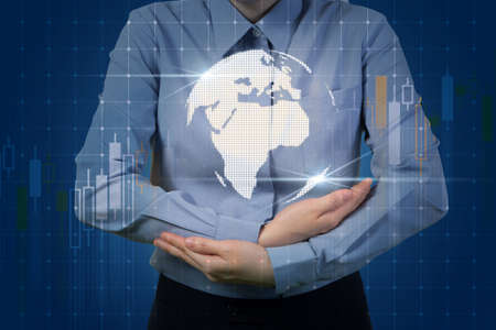 businesswoman holding virtual world map with stock market, business investment concept. 版權商用圖片