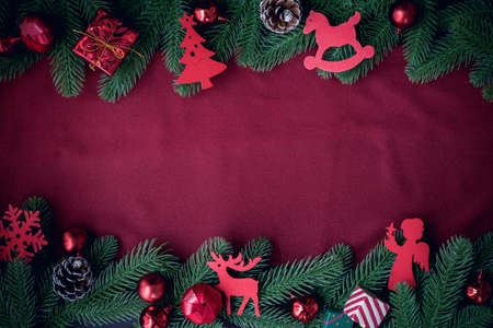 Copy space on Red fabric texture and Christmas frame background with decorations, view from above.