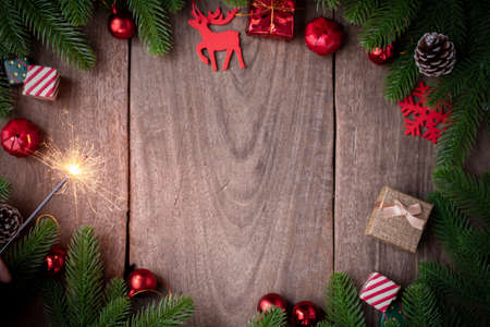 Christmas background with decorations and firework on wooden board, view from above wooden board.