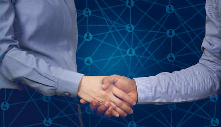 handshake business partners with virtual contact customer and business stock market chart, concept of business commitment.