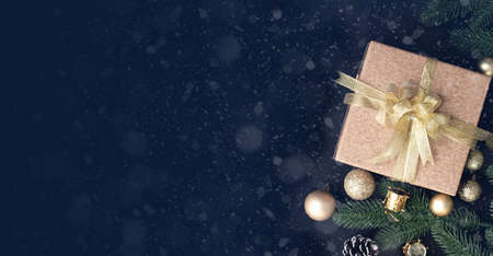 Christmas gift, present box and Christmas decorations background, view from above, wide Christmas background.
