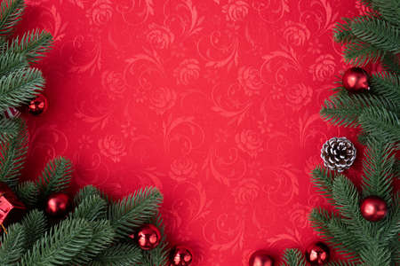 Red Christmas texture background with Christmas decorations, view from above table.