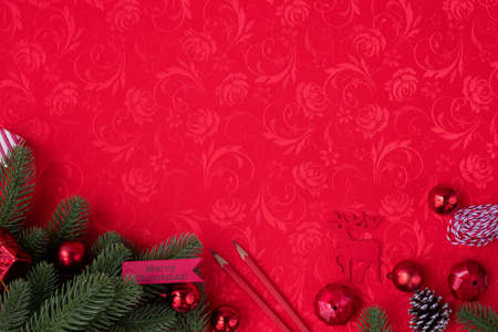 Red Christmas texture  with Christmas decorations frame, view from above table. Stock fotó
