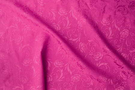 Pink Creased fabric texture background, copy space.