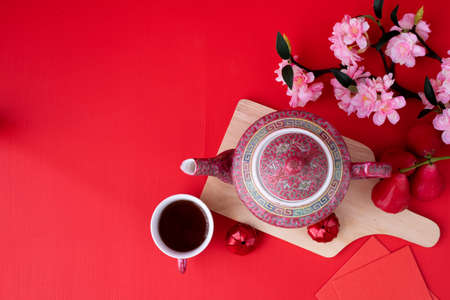 Top view on Chinese new year Background concept with teapot and Sakura flower.