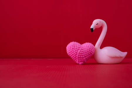 Copy space on Red Valentines background with Alone bird toy.