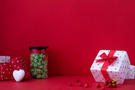 Copy space on Red Valentines background with Gift boxes and dessert.