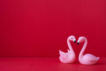 Copy space on Red Valentines background with Couple bird toy.