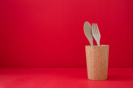 Copy space on Red Valentines background with Wooden spoon and fork. Stock fotó