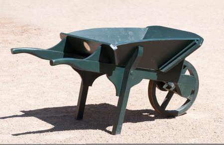 An old painted wooden wheelbarrow