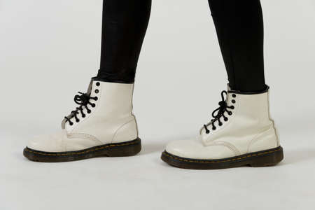 White boots and black leggings 版權商用圖片