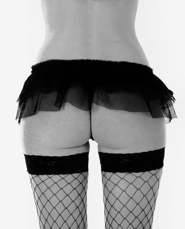 Woman in fishnet stockings and knickers