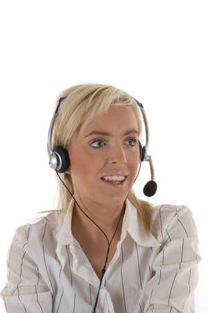 A pretty blonde female receptionist with headphones and microphone