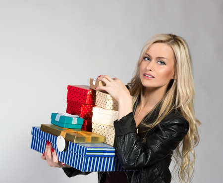 Blonde Woman Holding Presents