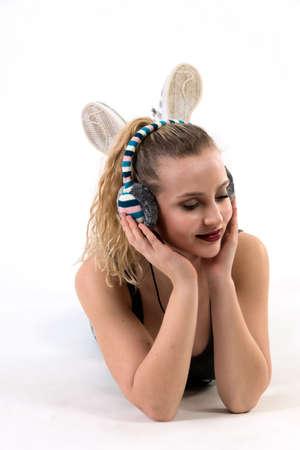 Young Woman Listening on Headphones Lying down 版權商用圖片