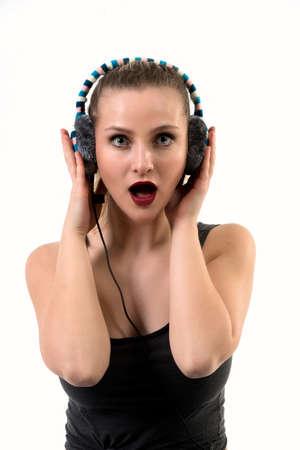 Surprised Woman Listening on Headphones - mouth open 版權商用圖片