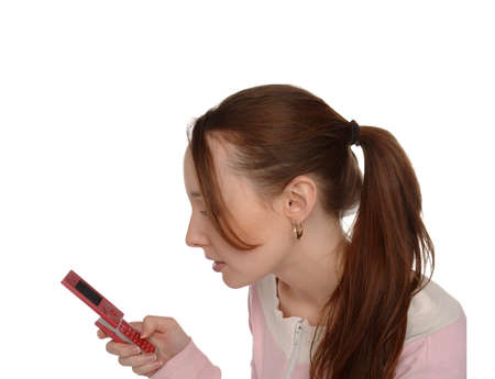A girl with ponytail texting on her mobile