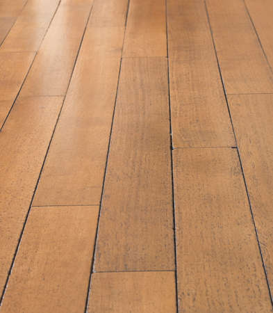 Polished Wooden Floorboards reflecting light