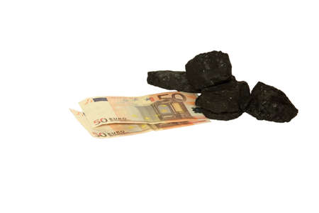 Money and coal Stock Photo