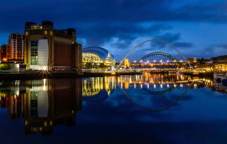 Newcastle Gateshead reflections of the Queyside over the river Tyne UK 報道画像