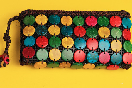 shoulder buttons: Colorful purse with stones and wood set into it Stock Photo