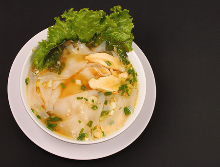 beansprouts: Glass noodle soup with chicken and beansprouts on a black background Stock Photo