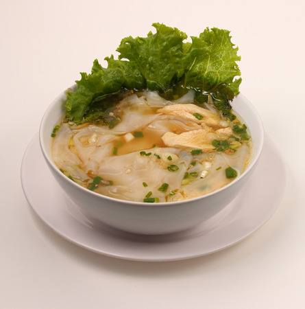 beansprouts: Glass noodle soup with chicken and beansprouts on a white background Stock Photo