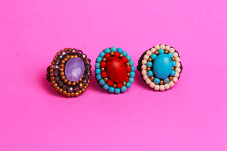 shiney: Stones set in rings against a pink background