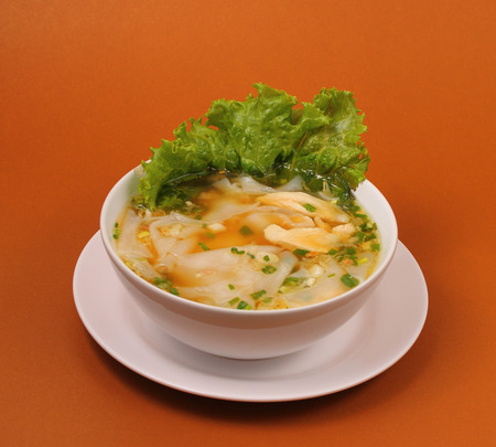 beansprouts: Glass noodle soup with chicken and beansprouts on a brown background Stock Photo