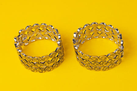Ornamental unusual rings set in a yellow background