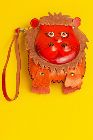 shoulder buttons: Colorful purse with animal face on front