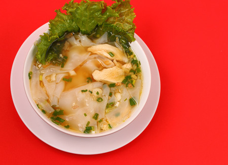 beansprouts: Glass noodle soup with chicken and beansprouts on a red background Stock Photo