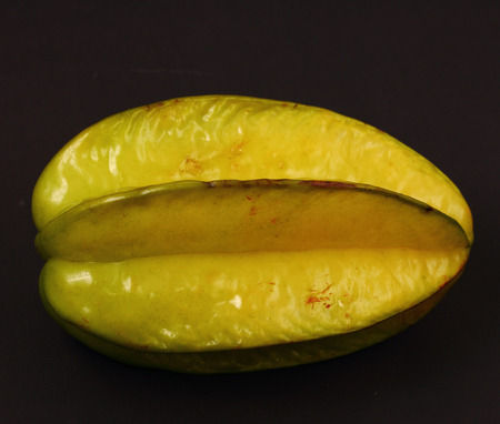 star fruit: isolated star fruit on a black background Stock Photo